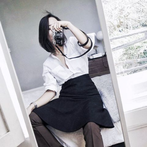 layering clothes: Shini Park wearing a skirt over flares