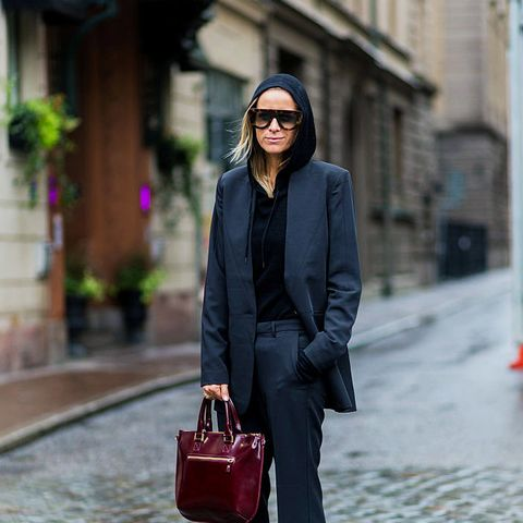 layering clothes: Celine Aagaard layers a hoodie under a blazer