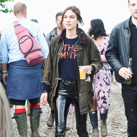Alexa Chung style: in vinyl trousers and a Barbour jacket at Glastonbury