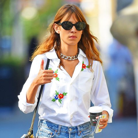 Alexa Chung style: wearing denim cut offs and a white shirt