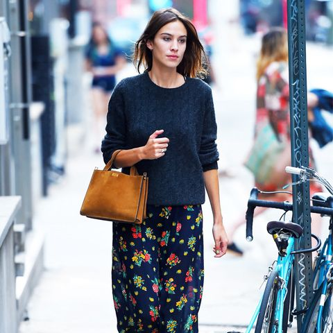 Alexa Chung style: wearing a navy jumper and floral maxi skirt
