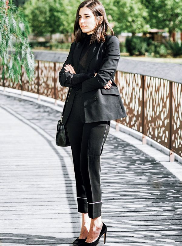 Style Notes: Being French, Aria Di Bari knows a thing or two about wearing black—it's the backbone of any excellent wardrobe français. Here she mixes a few different finishes together: Satin...