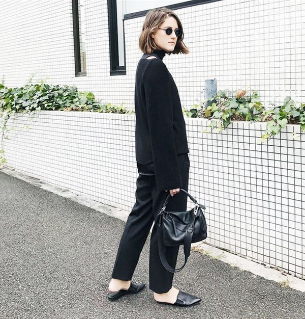 Style Notes: Blogger and fashion designer Charlie May proves that an all-black look can be instantly uplifted via statement accessories: Slip-on mules, round shades and a luxe leather handbag are...