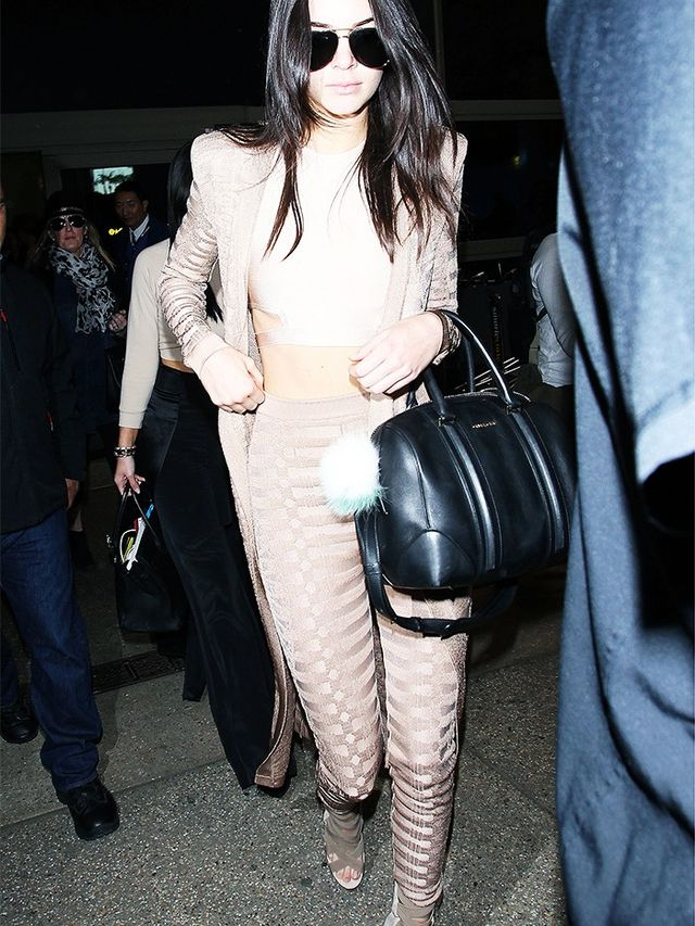 On Kendall Jenner: Balmain Stretch Viscose Long Cardigan (£1,440) and trousers; House of CB crop top; Givenchy bag.