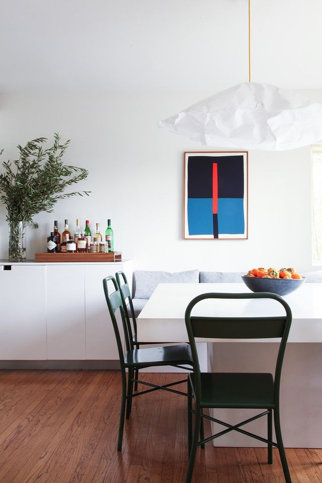 Appel's favorite part of the design is the kitchen dining area, for which Heron designed a custom white concrete table and bench seating. The ability to create custom furnishings has been an...