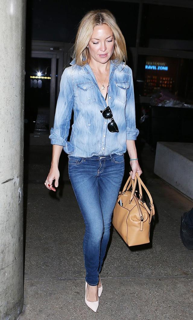 On Kate Hudson: Dsquared2 shirt; Michael Kors bag.