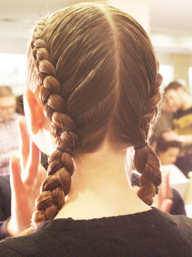 """Want to try out this look yourself? Here are Turner's tips for achieving the bad gal braids, created entirely with Bumble and Bumble products: """"Create a strong center part and prep..."""