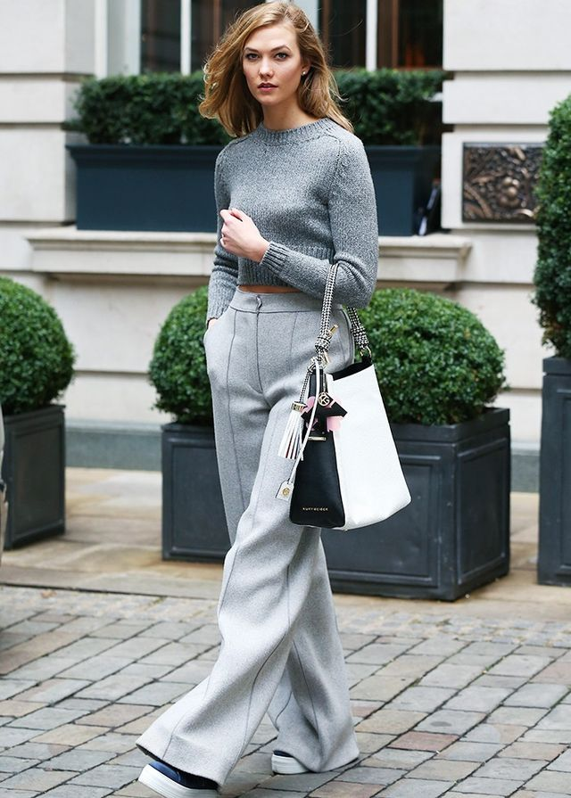 On Karlie Kloss: Elisabetta Franchi sweater; Amanda Wakeley trousers; Kurt Geiger London Woven Penelope Hobo (£295), Letter K Charm (£12) available in Blue, and Ladbrook...