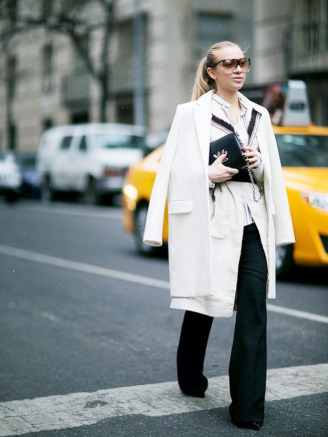 On Sandra Hagelstam: Pinko Long Coat(£365), jacket and shirt; Célinetrousers; Louis Vuittonbag;Loewesunglasses.