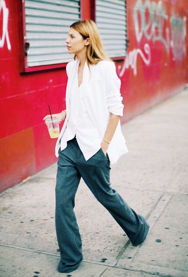 Untuck your shirt over wide-leg pants.