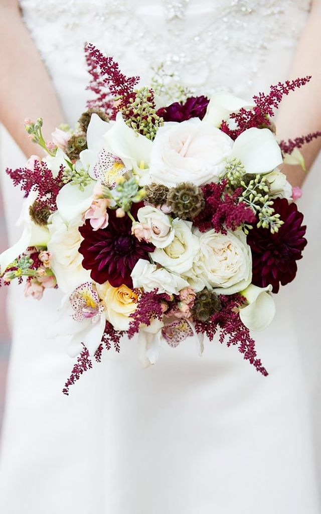 This bouquet is filled with all different types of flowers (roses, peonies, and orchids) and, therefore, lots of texture. The deep marsala dahlias are stunning, and the rich colour brings to mind...
