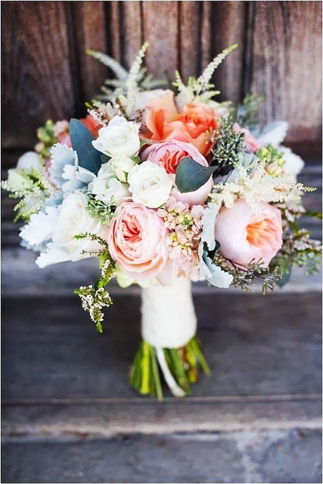 Feathery soft peach peonies are the focal point of this bouquet. In the language of flowers, peonies relay a message of bashfulness, but when you carry a clutch this pretty, we doubt you'll...