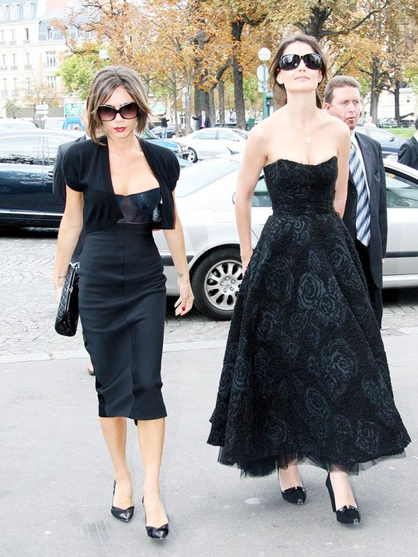 Victoria Beckham with Katie Holmes at Paris Fashion Week, October 2006