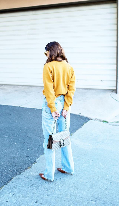 On Courtney Trop:Céline Round-Frame Sunglasses(£210); vintage sweater; vintage Levi's jeans; GucciDioynsus Bag (£1480) in beige suede; Manolo Blahnik...