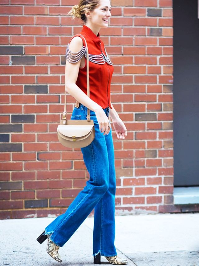 On Sofia Sanchez: Chloé Georgia Bag (£575). Style Notes: Apple red blends so well with classic blue denim and beige tone accessories.