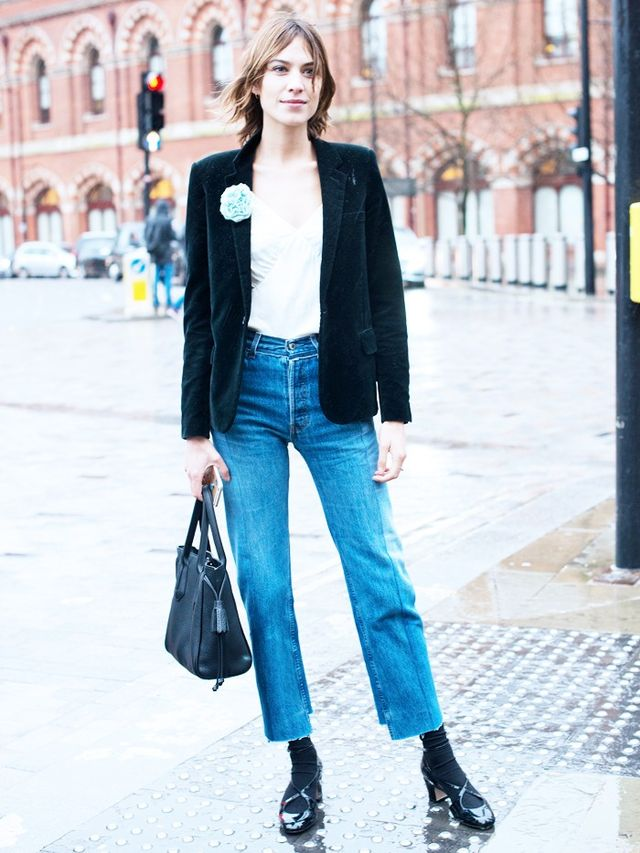 On Alexa Chung: Longchamp bag; Vetements jeans. Style Notes: Textures are important in the formation of a slick outfit. Go for velvet, silk and denim to contrast the Alexa way.