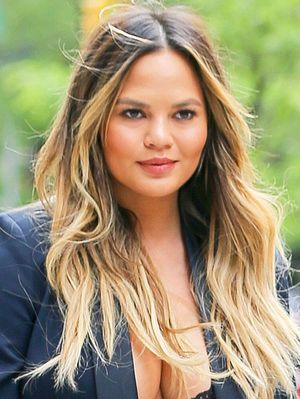 Chrissy Teigen Paired Something Totally Unexpected With a Pantsuit