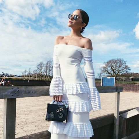 Olivia Culpo fashion style: Alexis Sylar Gown, Aspinal of London The Mini Trunk Clutch