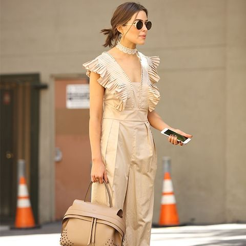 Olivia Culpo fashion style: tibi jumpsuit, tod's tote, and Giavito rossi suede sandals