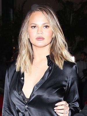 A Blouse as a Dress? Chrissy Teigen Goes for It