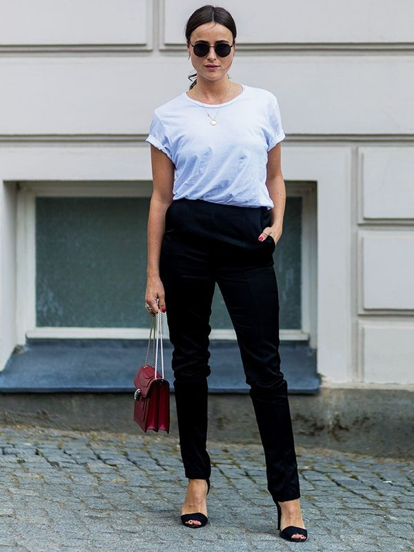 Style Notes: Lena Lademann convinces us there is nothing better than a white tee and black trousers—especially when they're accessorised with a Bulgari bag.