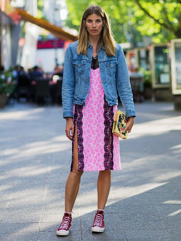 Style Notes: Diffuse the girlishness of a lace slip dress like Veronika Heilbrunner—thrown on a denim jacket and add Converse hi-tops.