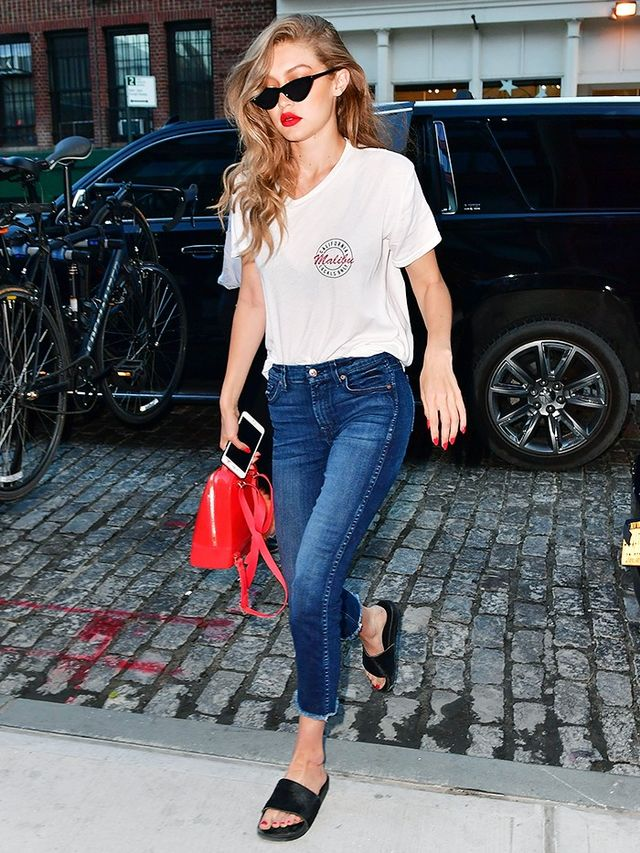 On Gigi Hadid:Brandy Melville T-shirt; 7 For All MankindThe Ankle Skinny Jeans(£157); Adam Selman x Le Specssunglasses; Furlabag; Adidas Adilette Premium Slides...