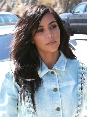 Only Kim Kardashian West Could Look Good in a Lace-Up, Acid-Wash Skirt Suit