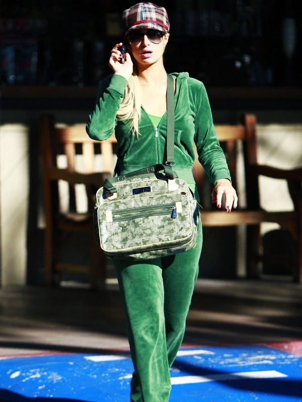 00s fashion trends: Paris Hilton wearing a green Juicy Couture velour tracksuit and trucker hat