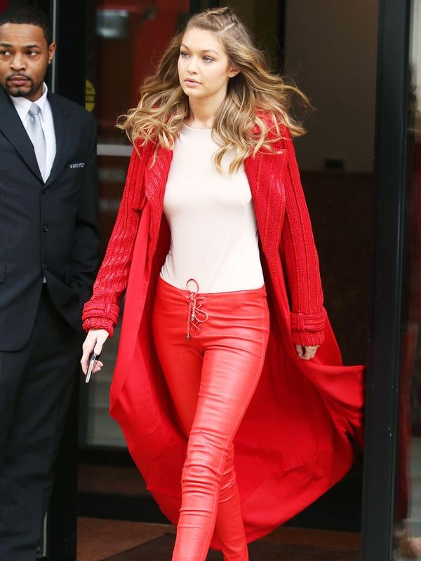 00s fashion trends:  Gigi Hadid wears red leather lace up trousers