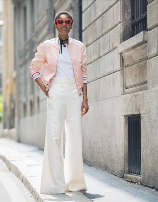 Style Notes: How to make that pink bomber jacket look totally cool? Pair with wide-leg pants and some OMG sunglasses. Tamu's perfect-fit trousers are the now-reduced Stella McCartney Lionel Slub...