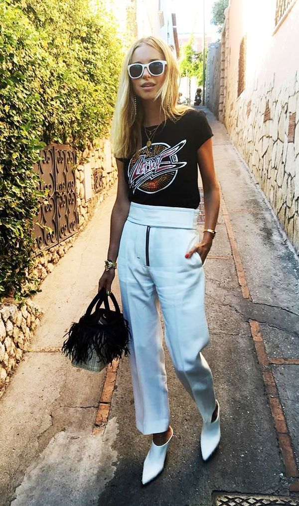 2.White accessories are an understated way to make your outfit pop. On Pernille Teisbaek: Lowe Print T-Shirt Black($275); Céline pants.