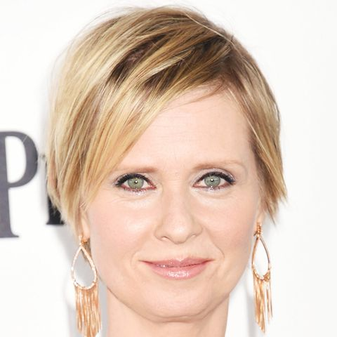 Cynthia Nixon's short hairstyle is a pixie crop with pretty golden highlights