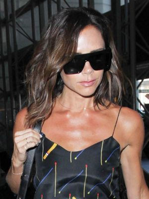 Victoria Beckham's Latest Airport Outfit Is Quite Dressy