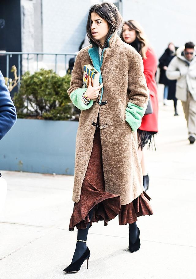 Leandra Medine wearing a Saks Potts coat during NYFW.