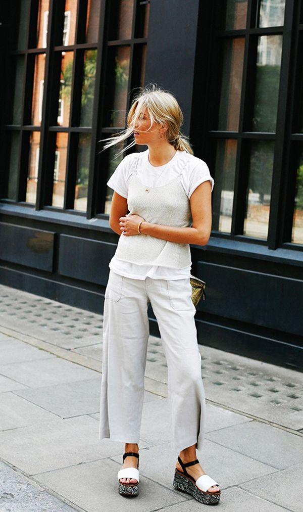 On Camille Charrière: Club Monaco top; Club Monaco Sheyna Pant ($178) ($139); Robert Clergerie shoes; Loewe clutch; Nike tee.