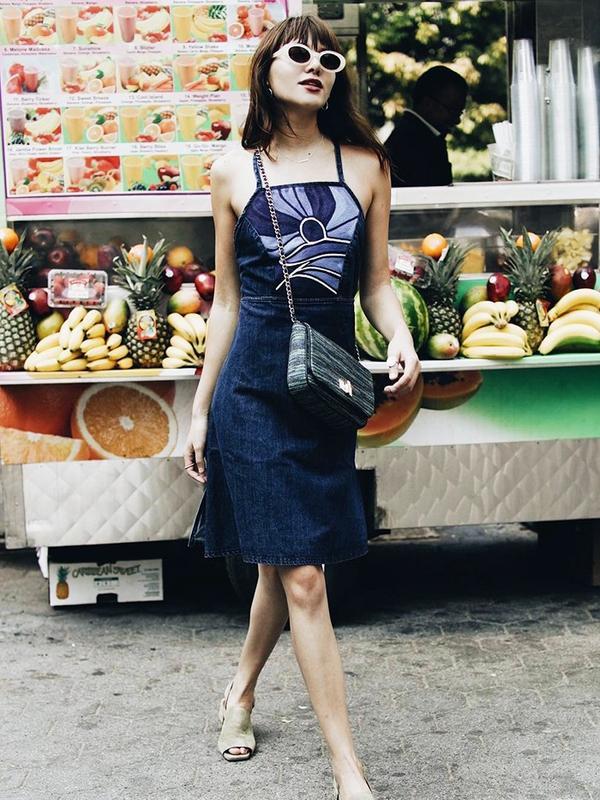 On Natalie Suarez: Lucky Brand Wrap Dress($148); By Far Scandi Strap Green Heel($288).