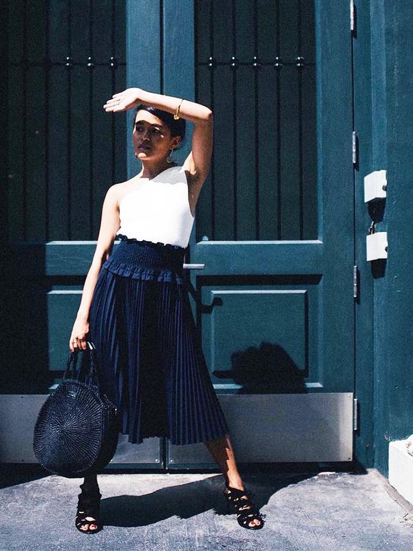 On Olivia Lopez: Aurelie Bidermann bracelet; Trademark skirt; Clare V. Alice Bag($199); Balenciaga sandals.