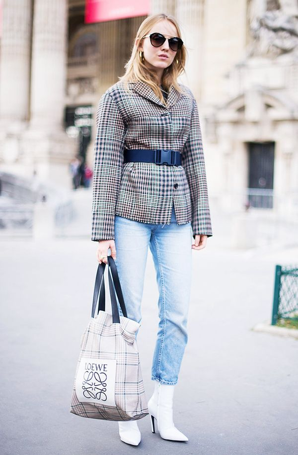 What better way to accessorize your belted blazer, light-wash jeans, and white boots ensemblethan with a cool Loewe tote?