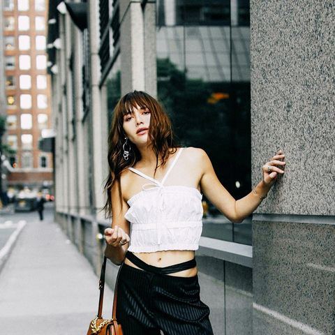 Pinstripe pants instantly become less serious when worn with a flirty crop top.