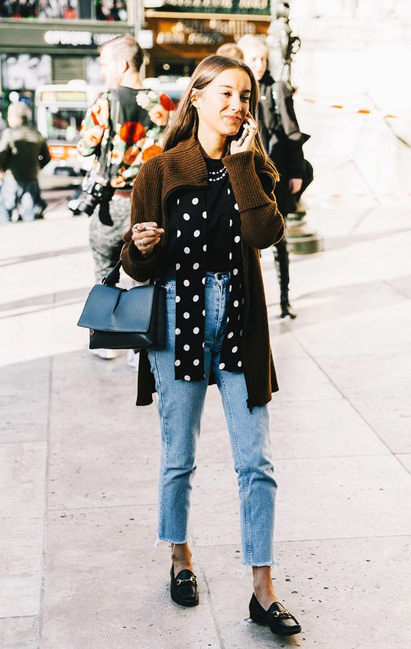 Jeans and loafers at fashion week.