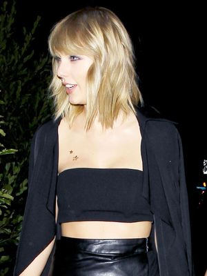 Taylor Swift Wore a $90 Trench Coat to Drake's Birthday Party—Shop It Here
