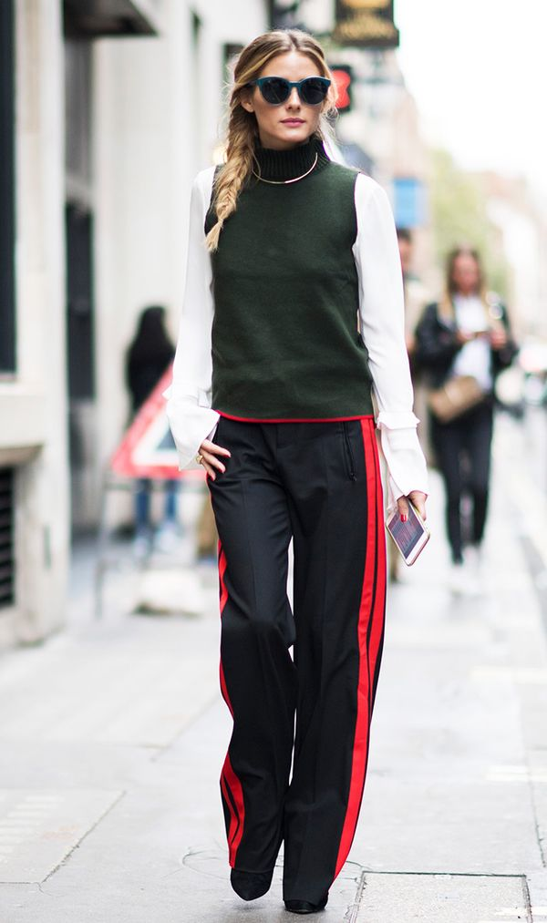 This is how you can pull off track pants for the office if you work in a creative setting—pair them with a blouse and a turtleneck sweater like Olivia.
