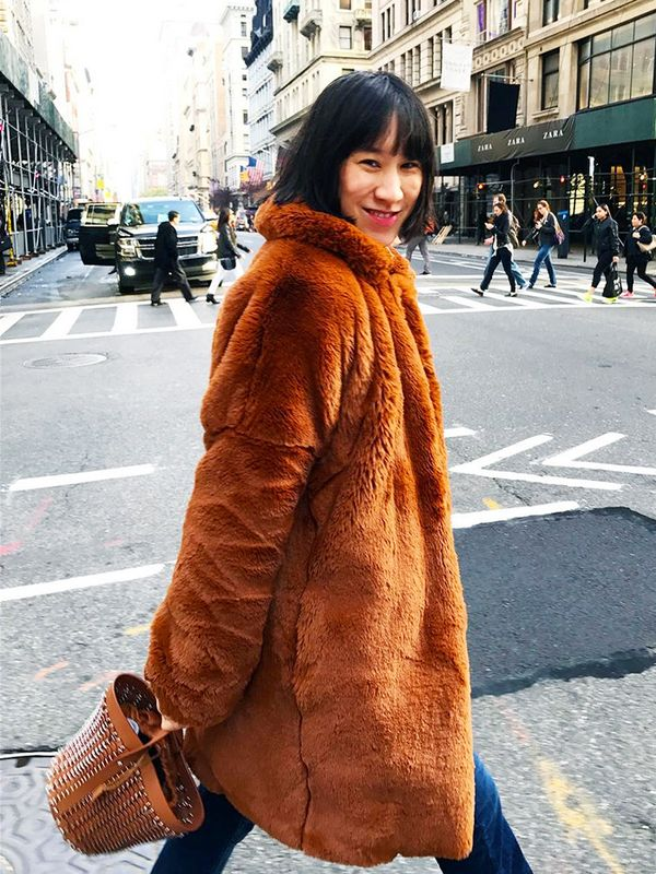 Eva Chenbraves the chilly streets of New York City in a fluffy statement coat.
