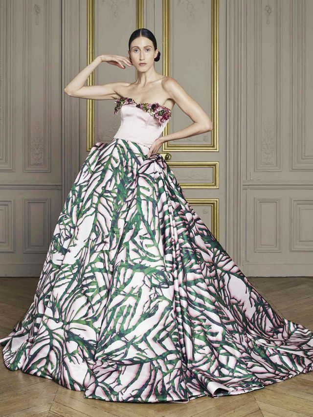 Style Notes: Ignore the print; the full skirt and strapless gown are classic bridal attire.