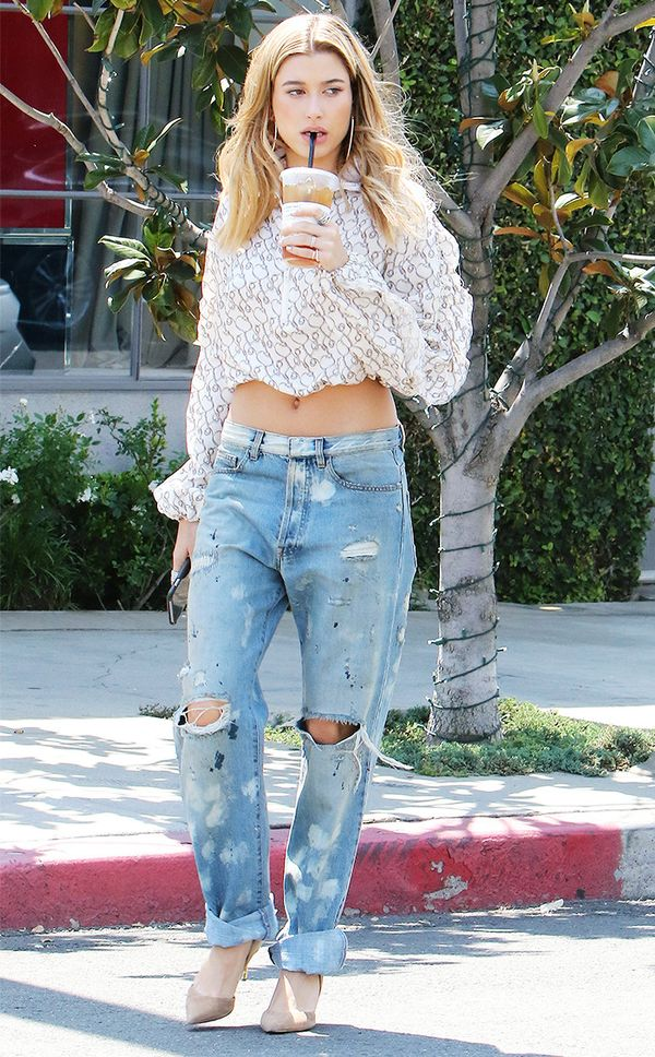 Style Notes: Who'd have thought of wearing baggy boyfriend jeans like this before? A lightness is added to her paint-splattered denim with nude heels and a billowing blouse.
