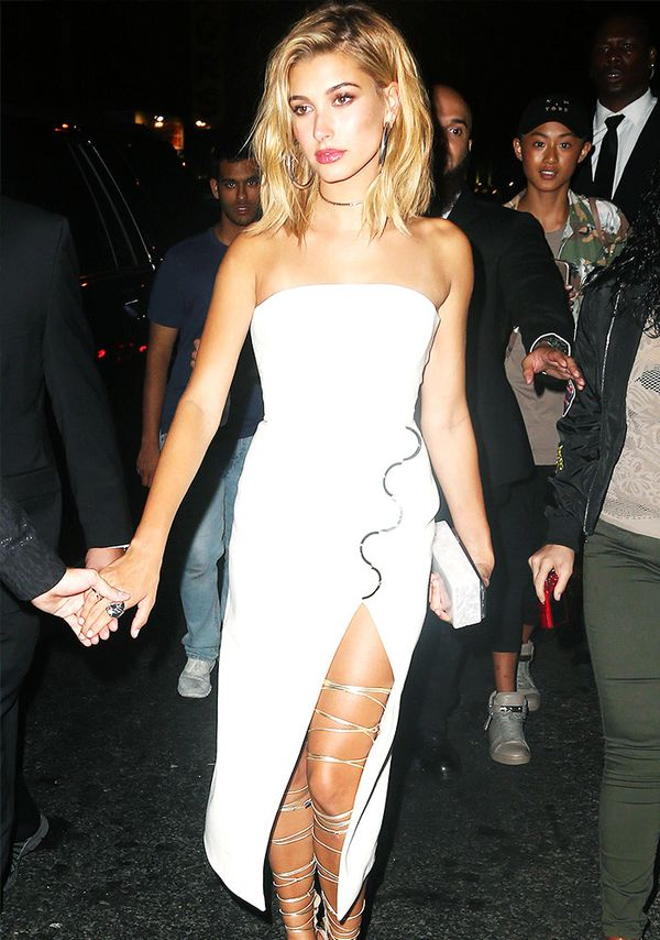 Style Notes:Thigh-high lace-up sandalspeeking out from a thigh split? It must be HB on a glam night out wearing her favourite Dsquared2gladiators.