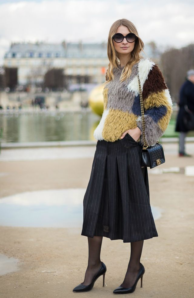 Style Notes: Classic black sheer tights always look so ladylike; they instantly dress up this look with a pleated skirt and comfy sweater.