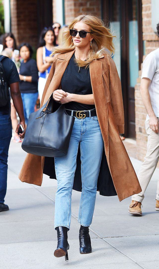 Rosie Huntington-Whiteley in Tribeca wearing jeans, Gucci belt, and camel coat.