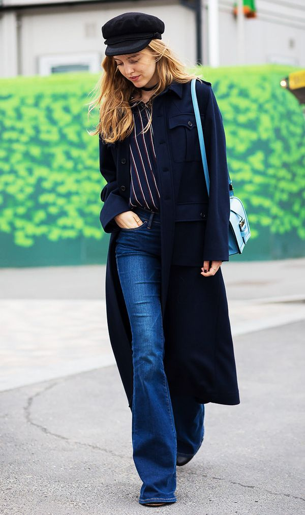 Want instant cool-girl vibes? This '70s-inspired outfit should do the trick. Pair a long coat with a striped shirt and flares. Finish it off with a cap.